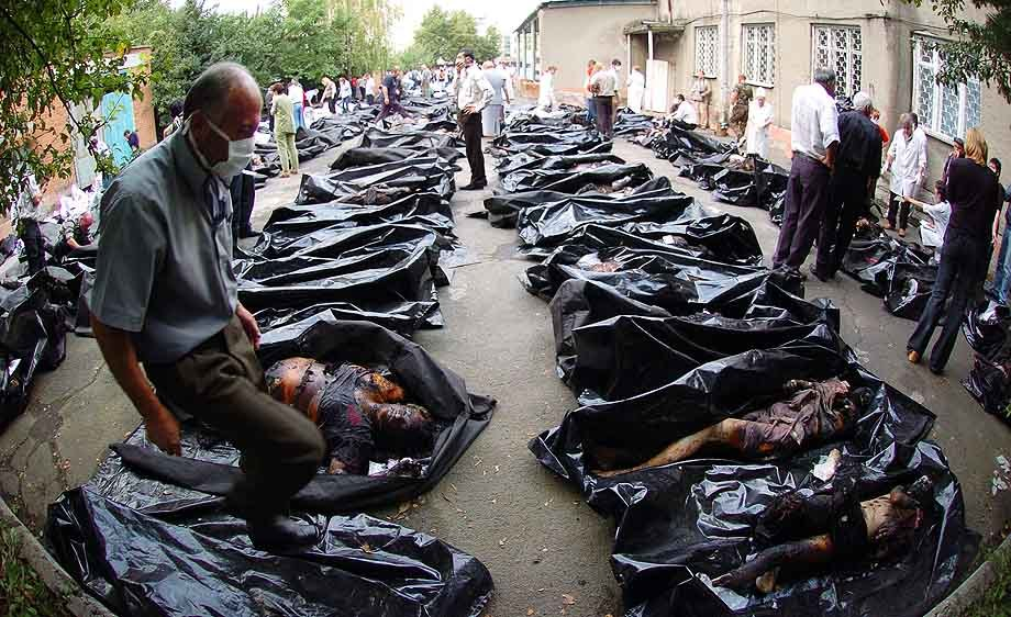 VLADIKAVKAZ, RUSSIA: Sept. 4-- Russian relatives identify the bodies of 350 who died the day after a three-day hostage drama of more than 1200 people held captive by Chechen rebels came to a violent end at a Beslan school, on September 4, 2004. (Photo by Scott Peterson / Getty Images)
