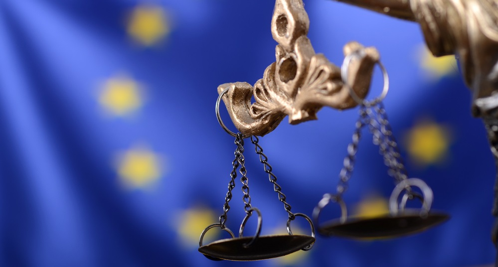 Law and Justice, Legality concept, Scales of Justice, Justitia, Lady Justice in front of the European Union flag in the background.